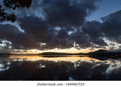 Clouds, Reflections and Sunrise Waterscape - Koolewong Waterfront on the Central Coast, NSW, Australia.