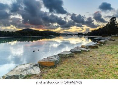 Clouds, Reflections and Sunrise Waterscape -  Woy Woy Waterfront on the Central Coast, NSW, Australia.