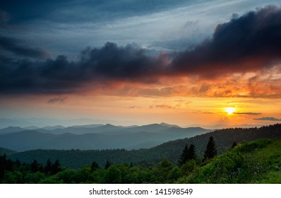 The clouds are rising as the sun is setting on the Blue Ridge Parkway near Asheville and Waynesville, North Carolina.