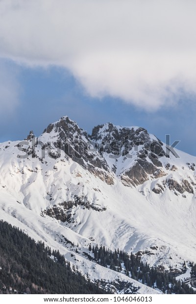 Clouds roll over the snow covered mountains of Innsbruck in Austria. Snow's melting. Finally.