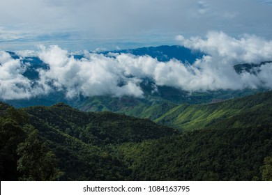Clouds rolling over green mountains in Northern Thailand