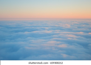 Clouds seen from above on sunrise texture