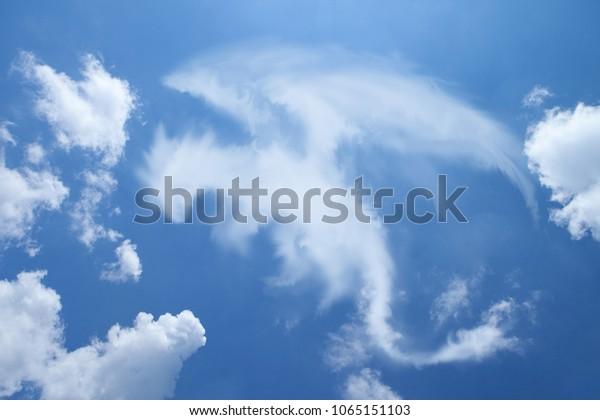 Clouds shaped like a Dragon.