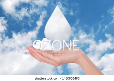Clouds shaped like drops ozone of water in woman hands on blue sky background  - Shutterstock ID 1480936493
