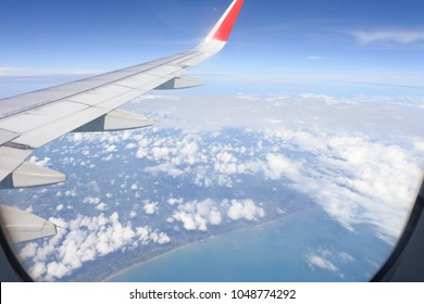 clouds and sky as seen through window of an plane