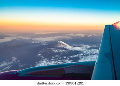 clouds sky skyscape and fuji mountain. Sunrise view from the window of an airplane flying in the clouds, top view clouds like the sea of clouds sky background, Aerial view background, Yamanashi, Japan