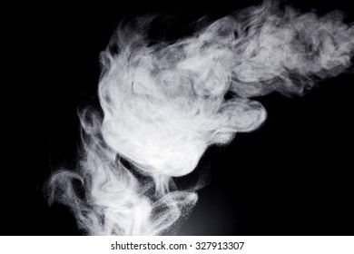 Clouds of steam on a black background.