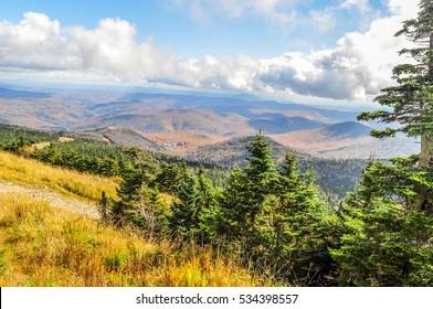 Clouds stream close over a landscape of autumn colors near Rutland, Vermont.