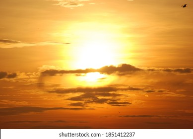 Clouds and Sun in the Yellow Sky