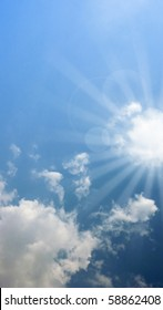 clouds and sunlight rays over blue sky. Perfect for spiritual and religious concepts.