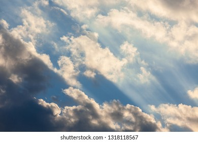 Clouds and sunrays at sunrise sky scape background