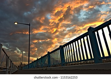 Clouds at sunset on bridge in Tokyo
