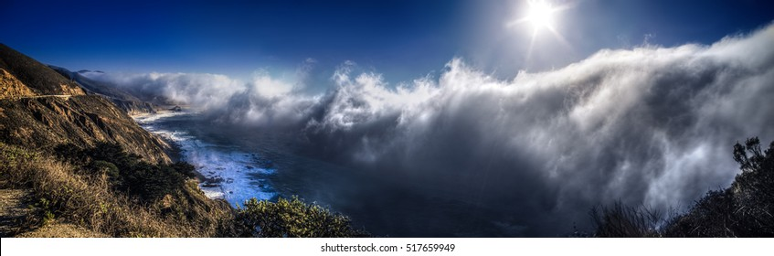 Clouds and thick fog in Big Sur California coming towards the pacific coast highway coastline like a tsunami or tidal wave.