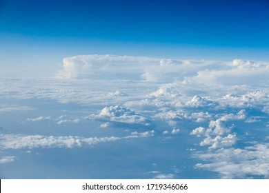 Clouds top view of the airplane. Heavenly landscape