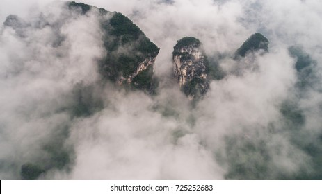 clouds twining round the green mountain
