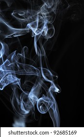 Clouds of White Smoke on Black Background