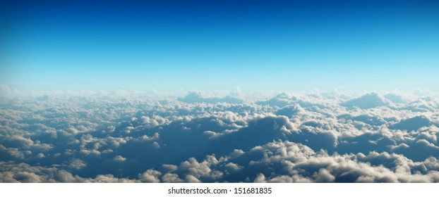 Clouds in widescreen view on blue background