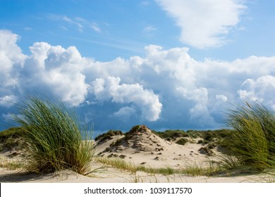 Clouds and wind over dunes of norderney  wild beach nature