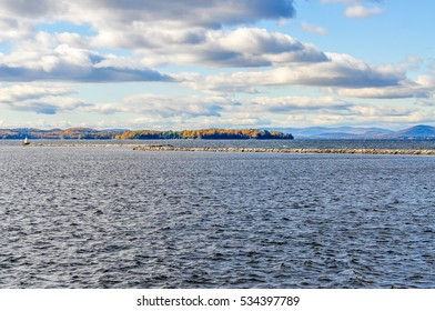 Clouds wisp across the turbulent waters of Lake Champlain in Burlington, Vermont.