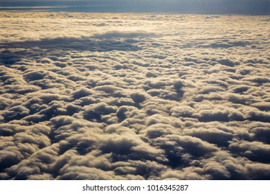 The cloudscape in from airplane in the backlight.