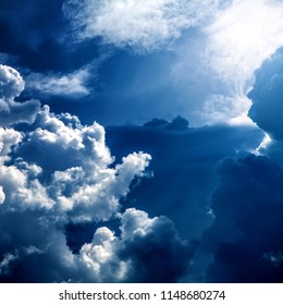 Cloudscape Background with Sun and Blue Sky