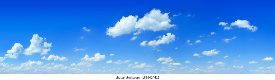 Cloudscape - Blue sky and white clouds, wide panorama