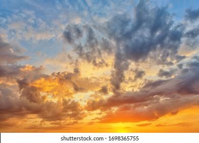 Cloudscape of cumulus sunset clouds with sun light