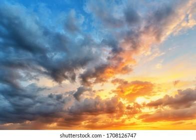 Cloudscape of cumulus sunset clouds with sunlight