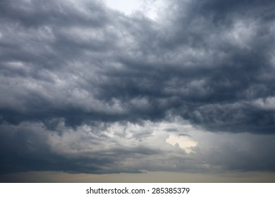 cloudscape with dark rainy clouds in the evening spring sky
