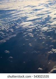 cloudscape with different types of clouds below, view from a plane