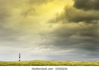 cloudscape and lighthouse at belgian coastline