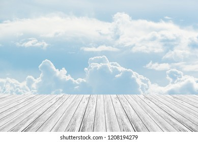 Cloudscape of natural sky with blue sky and white clouds in the sky use for wallpaper background with wood table or terrace