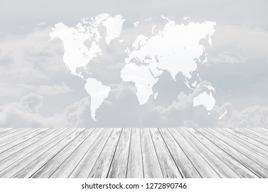 Cloudscape of natural sky with blue sky and white clouds in the sky use for wallpaper background with wood table or terrace and world map