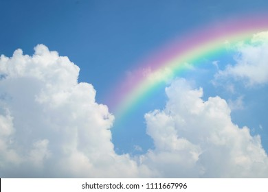 Cloudscape rainbow of natural sky with blue sky and white clouds and colorful rainbow in the sky use for wallpaper background