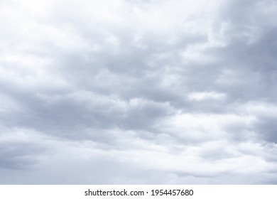 Cloudscape scenery, overcast weather above dark blue sky. Storm clouds floating in rainy day, abstract of natural atmosphere. White and grey scenic environment background. Nature scenic. - Shutterstock ID 1954457680