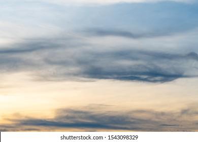 Cloudscape and sky in evening. Season summer sunset color orange sky.