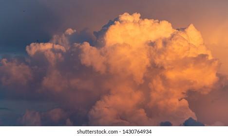 Cloudscape sunset nature background. Beautiful dramatic heaven sunlight.