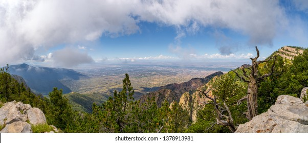 Cloud-Topped Panoramic View of Albuquerque.  Clouds cap this gorgeous, wide-view shot of Albuquerque from the Sandia Mountain.