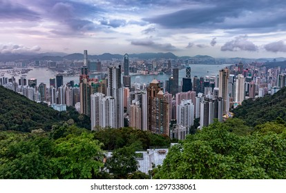 A cloudy afternoon over the modern skyline of Hong Kong, elevated view over Victoria Harbour and Central