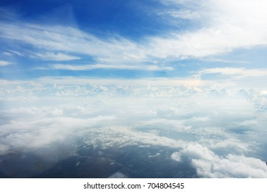 Cloudy of bird eye view from airplane window.