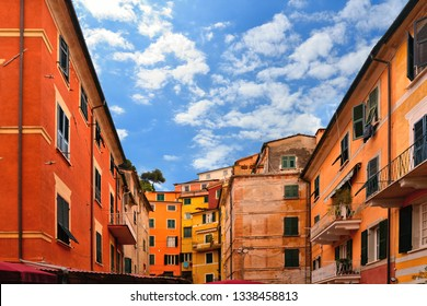 cloudy blue sky, colorful facade of old architecture buldings and windows in old historical part in Lerici in Liguria, Italy