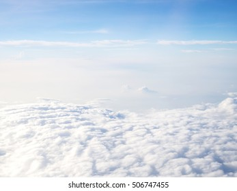 Cloudy with blue sky. Nature and abstract background. Blue sky from airplane window view. Likes heaven on earth.