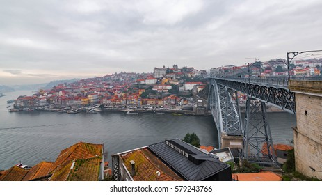 Cloudy city of Porto with Dom Luis I Bridge