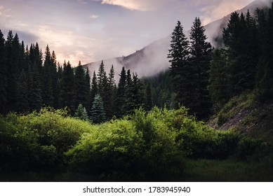 Cloudy Colorado mountain scenery during sunset.