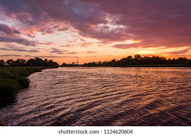 Cloudy colorful sunset over Wisla river in Krakow, Poland
