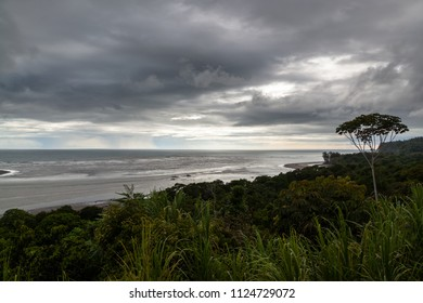 A cloudy and dark afternoon in the southern Pacific coast of Costa Rica with a beautiful coastal view>