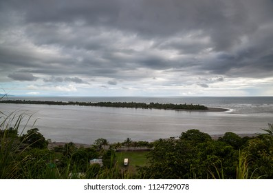A cloudy and dark afternoon in the southern Pacific coast of Costa Rica with a beautiful coastal view.