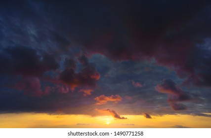 cloudy and dark dramatic cloudscape at sunset