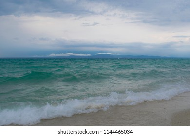 a cloudy day at sea with waves