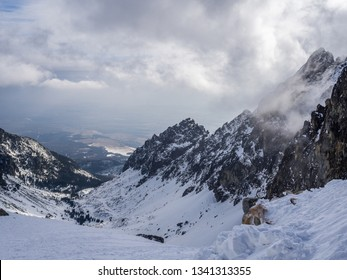 The cloudy day view of Hight Tatras rocky mountain range with Small Cold Valley (Malá studená dolina) in the background captured from Teryho Hut ( Téryho chata). High Tatras, Slovakia.
